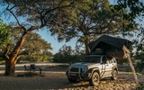 Camping area under acacia trees on the riverbed