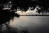 Watching the sunrise over the Okavango River from the campsite